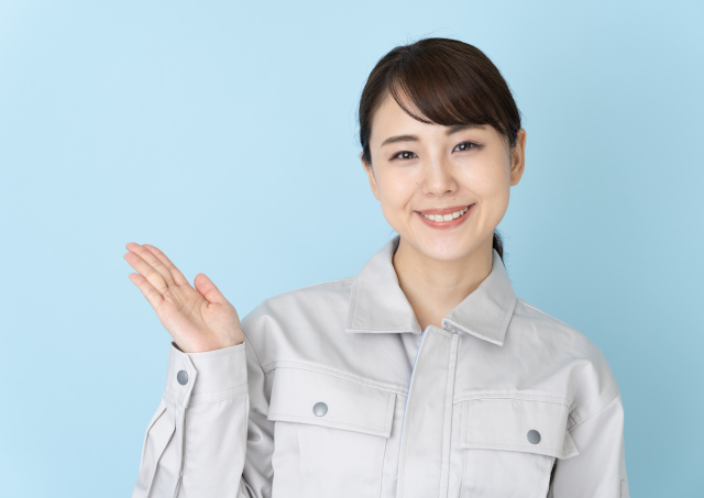 portrait of asian engineer woman on blue background